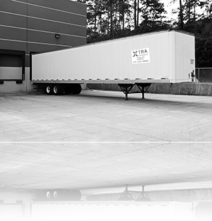 Storage mobile trailer for rent or lease from Xtra Storage docked at warehouse